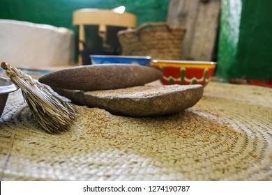 The ancient, stone, hand grain mill in traditional heritage Arabic house. Saudi Arabia