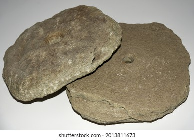 Ancient stone millstones for grinding grain, isolate.
