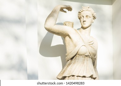 Ancient stone sculpture of the ancient Greek goddess Artemis. The statue of the goddess of hunting, fertility and chastity in the park of Yelagin island near the palace. The art of the ancient Greek.