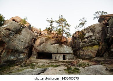 an ancient stone settlement. Unusual rock outcrops in nature reserve. Dovbush rocks, Ivano-Frankivsk region. Horizontal outdoors shot.Rocks and forest among the rocks.