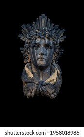 An ancient stone statue of God of Sun and sight Helios (Helius). Fragment of an ancient statue.  Often he is depicted with a radiant crown.