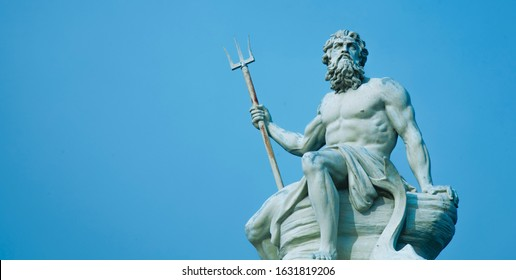 Ancient stone statue of mighty god of the sea and oceans Neptune (Poseidon) with trident.