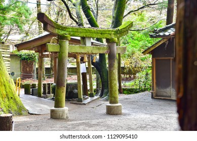 Ancient Stone Torii Gate at Tenson Shrine in Yufuin, Japan