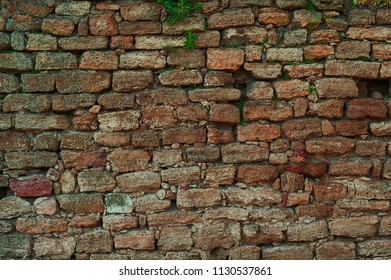 Ancient stone wall. Yellow grunge texture of old brick.
