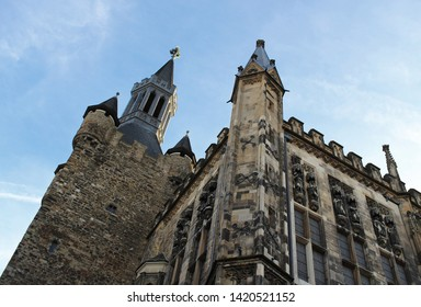 Ancient stone walls and details of Aachen Town Hall on a background of the evening sky, Aachen, Germany. One of the towers of the City Hall in the Gothic architecture styles.