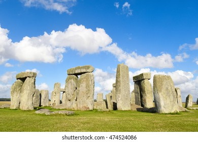 Ancient Stonehenge on a sunny day in England with clouds