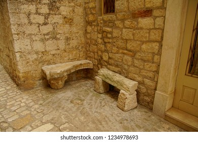 Ancient stones used for benches in courtyard of small hotel in Trogir, Croatia