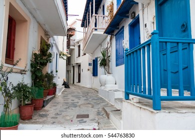 ancient streets of the town of skopelos with blue balcony