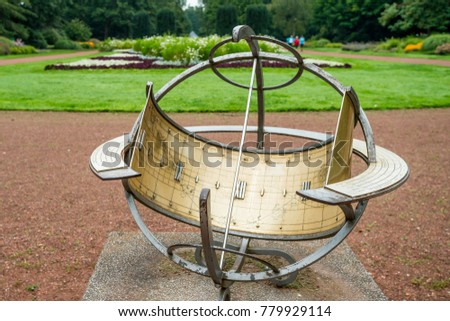 Ancient Sundial In Garden
