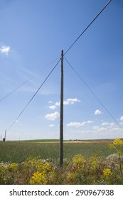 ancient telephone line cable pole in landscape field Castilla Spain