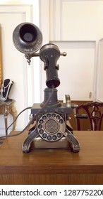 Ancient telephone on wooden table.Retro,vintage,collectible concepts.