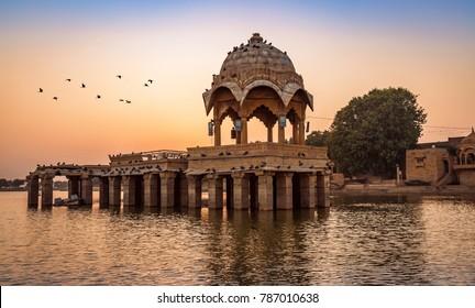 Ancient temple at Gadi Sagar (Gadisar) lake Jaisalmer Rajasthan at sunset