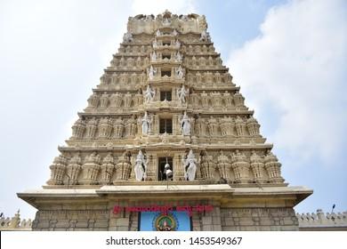 "Ancient temple in mysore, Karnataka, with "" Sri Chamundeswari devi Temple"" written in Kannada Letters"