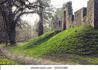 "Ancient temple on the terrain elevation surrounded by the forest. Ruins of ""Cammo House"" ,  part of ""Cammo Estate"" , Edinburgh, Scotland."