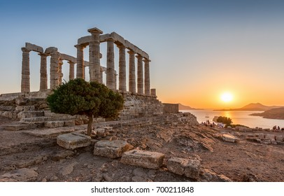 The ancient Temple of Poseidon during a summer sunset at Sounion, Attica, Greece
