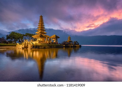 Ancient temple (Pura ulun danu bratan) reflection with colorful sky at sunrise. Bali, Indonesia