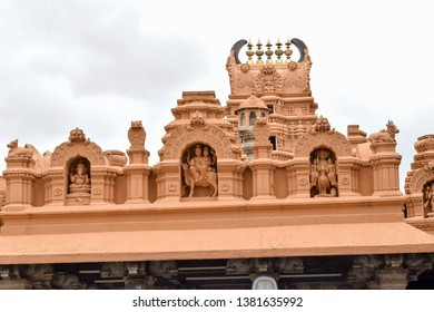 Ancient temple with a tall gopuram and mesmerizing stone carvings