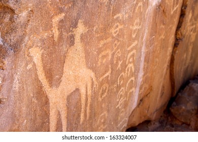 Ancient Text and Drawings Carved into Rock, Wadi Rum, Jordan