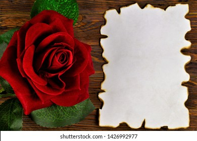 Ancient texture of old paper, background for writing and red rose. Vintage grunge paper with dark edges, rose flower Queen, background for literary composition, greeting, love holiday.