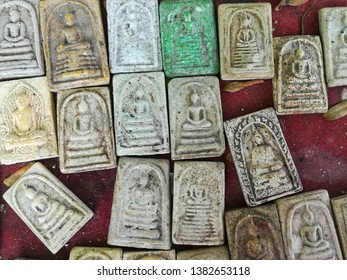 Ancient Thai Buddha amulets which are Buddha image with meditation statue. Amulet market in Thailand sale to pray for prosperity luck and health of Buddhist.