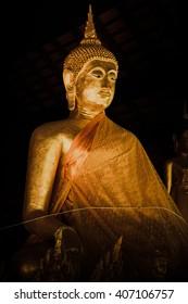 ancient thai golden buddha in dark background.