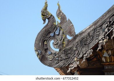 ancient thai temple Architecture: Naga wood carved at Chapel Roof of Wat Phra That Lampang Luang. Lampang, THAILAND.