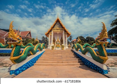 Ancient Thai temple. Wat Karon. Suwan Khiri Khet Temple Phuket, Thailand. Dragon stairs entrance.