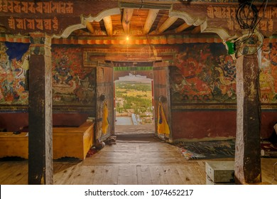 Ancient Thiksey monastery with view of murals on the inside wall and Himalayan mountians outside - it is a famous Buddhist temple in,Leh, Ladakh, Jammu and Kashmir, India.