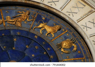 Ancient time and Astrology. Detail of Saint Mark Square renaissance Clock Tower in Venice with zodiac signs Leo, Cancer, Virgo, planet and stars (15th century)