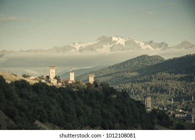 Ancient towers in Mestia on mountains backdrop, vintage landscape, Georgia