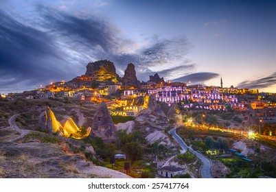 Ancient town and a castle of Uchisar dug from a mountains after twilight, Cappadocia, Turkey