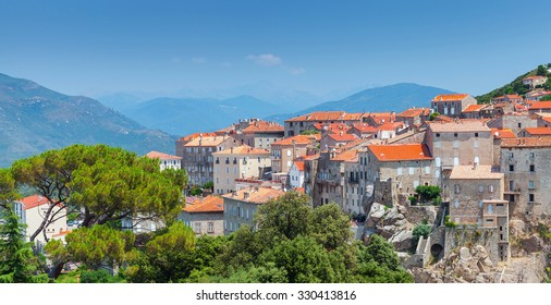 Ancient town cityscape with stone houses and red tile roofs. Sartene, South Corsica, France