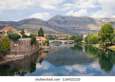 Ancient town on river bank. Bosnia and Herzegovina, Republika Srpska. View of Trebisnjica river and Old Town of Trebinje