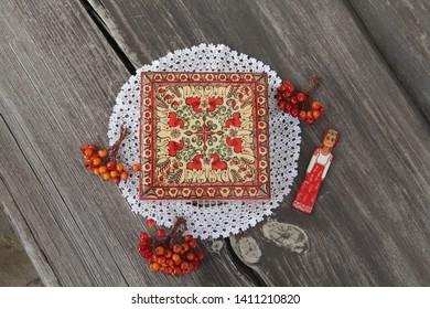 Ancient traditional folk russian handcraft: Mezen painting on wooden casket in russian style