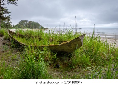 An ancient traditional hand carved Haida canoe left behind on the beach on the North shore of Graham Island near Tow Hill in Naikoon Provincial Park in Haida Gwaii, British Columbia, Canada.