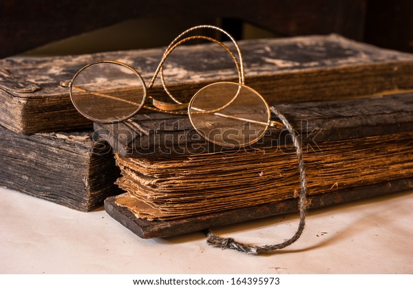 Ancient Treatise with very old glasses retro style