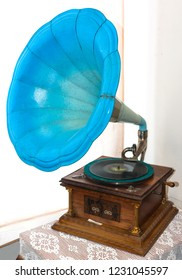 Ancient turquoise gramophone on nightstand