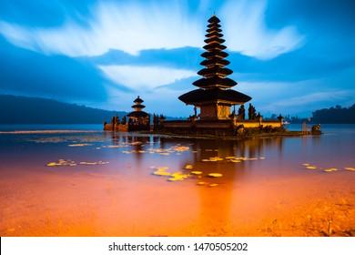 Ancient Ulun Danu Beratan Temple or Pura Bratan, Indonesian Hindu water temple on on the shores of Lake Bratan in the mountains near Bedugul, Bali at sunset.