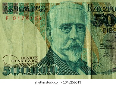 Ancient, used, out-of-date Polish 500000 zloty currency banknote. This bill is no more in use after redenomination in 1995. Only less than 75% is displayed. Henryk Sienkiewicz writer portrait.
