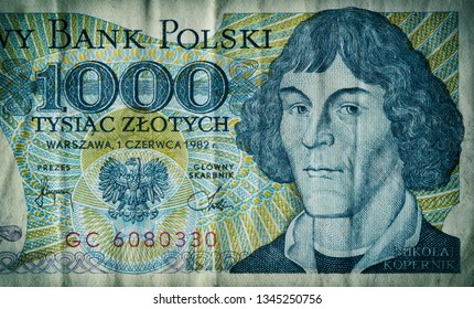 Ancient, used, out-of-date Polish thousand zloty currency banknote. This bill is no more in use after redenomination in 1995. Only less than 75% is displayed. Nicolaus Copernicus portrait.
