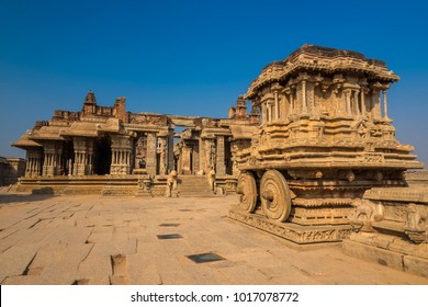 Ancient Vijaya Vittala temple with stone chariot well known for its exceptional architecture in Hampi, India. These ruins are from the Hindu Vijayanagara empire which existed in the 14th century.