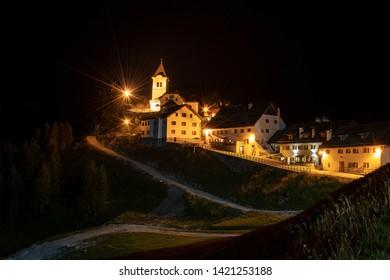 Ancient village of Monte Santo di Lussari (1790 m) at night in the Julian Alps. Tarvisio, Friuli Venezia Giulia, Italy, Europe