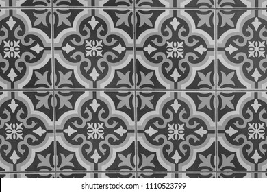 ancient vintage black ceramic tiles on cement wall decoration