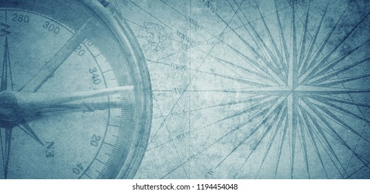 Ancient vintage blue map and compass  background. Retro style. Science, education, travel, vintage background. History and geography team.