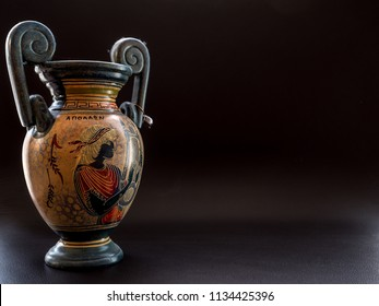 ancient vintage greek vase on black background with space for text studio light