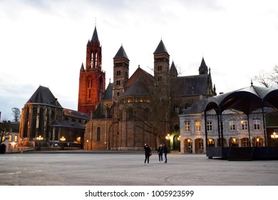 The ancient Vrijthof Square with the Saint Servatius Basilica and the St John Church , very olden monastery history in Maastricht, Limburg, Netherlands at dusk. Travel style and grain texture concept.