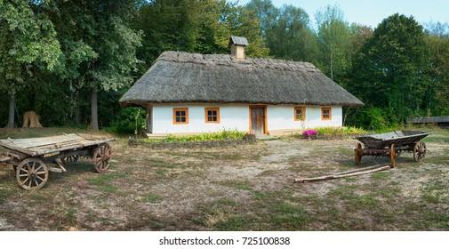 Ancient wagon near the house, Ukrainian village