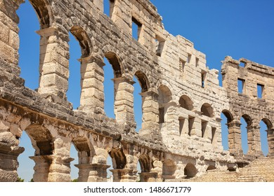 Ancient wall of amfitheater in Pula, Croatia. Historic heritage tourism and travel background