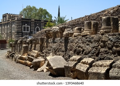 Ancient wall and archaeological remains of the town of Capernaum, home of St. Peter and Jesus in Israel