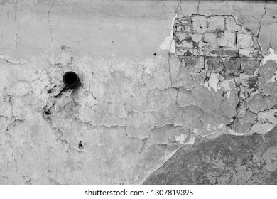 Ancient wall with black hole
